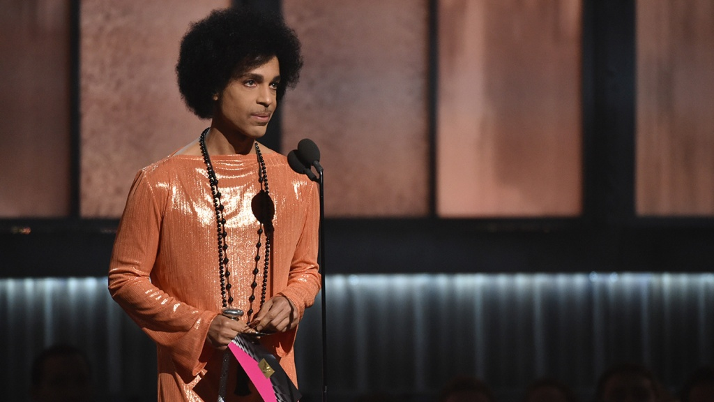 Prince presents the award for album of the year at the 57th annual Grammy Awards on Sunday, Feb. 8, 2015, in Los Angeles. (Photo by John Shearer/Invision/AP)